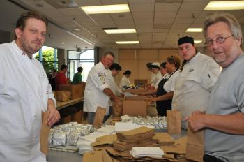 Volunteers Work Hard Assembling 6500 Bagged Lunches for Special Olympics